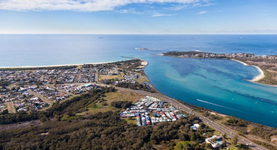 Aerial view of Blacksmiths Beach and Swansea Channel at the mouth of Lake Macquarie - Australia's largest salt water lake