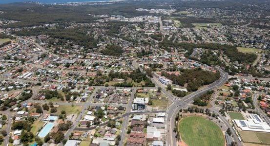 Aerial view of residential areas of Newcastle and Lake Macquarie. Charlestown Whitebridge and Gateshead surburbs looking south towards Readhead Beach and Lake Macquarie.